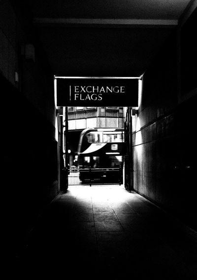 Text on illuminated subway station