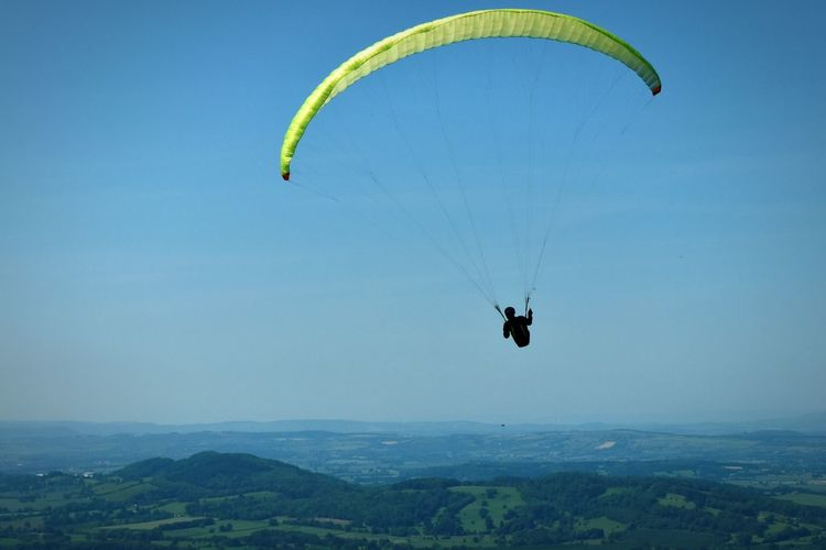Extreme Sports Parachute Flying Paragliding Adventure Mid-air RISK Landscape One Person People Air Vehicle Day Sky Pilot Outdoors Sport Nature Aerospace Industry Tree Adult Janis Buls