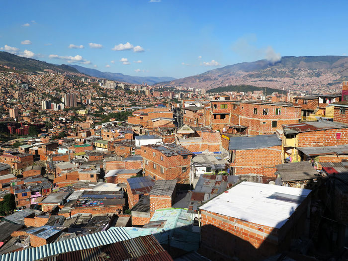 Walking around Medellin (2016). Architecture Building Exterior Built Structure Building Residential District City Mountain Roof Town Cityscape Sky House Community Day High Angle View Outdoors TOWNSCAPE Roof Tile Urban Skyline Urban Landscape South America Travel Destinations Travel Travel Photography View From Above
