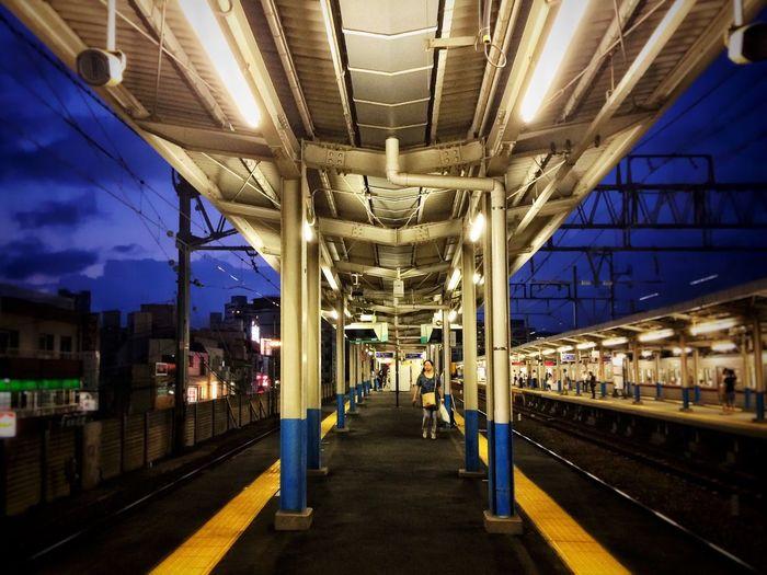 Train at railroad station at night