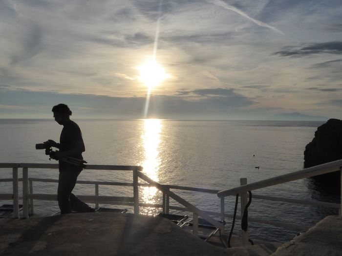 Sun Sky Real People Full Length Sunset Sea Nature One Person Sunlight Cloud - Sky EyeEm Best Shots Eye4photography  EyeEm Gallery Beauty In Nature Standing Water Men Beauty In Nature Horizon Over Water Outdoors Tranquility Silhouette Capri Lido Il Faro Italy