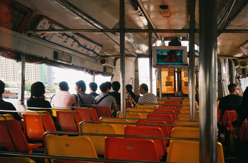 Group of people sitting in bus