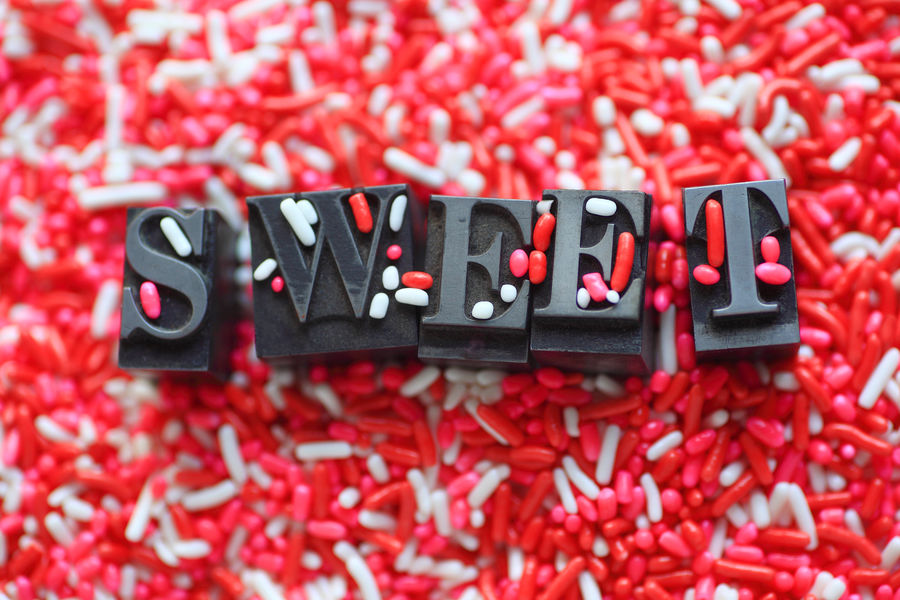 Candy sprinkles with the word sweet Background Candy Communication Copy Space Decorative Font Holiday Indoors  Letters Metal Type Multi-colored No People Overhead View Pink Red Sprinkles Sweet Textures Treats Typeface  Typography Valentine's Day  Vibrant Color White Word