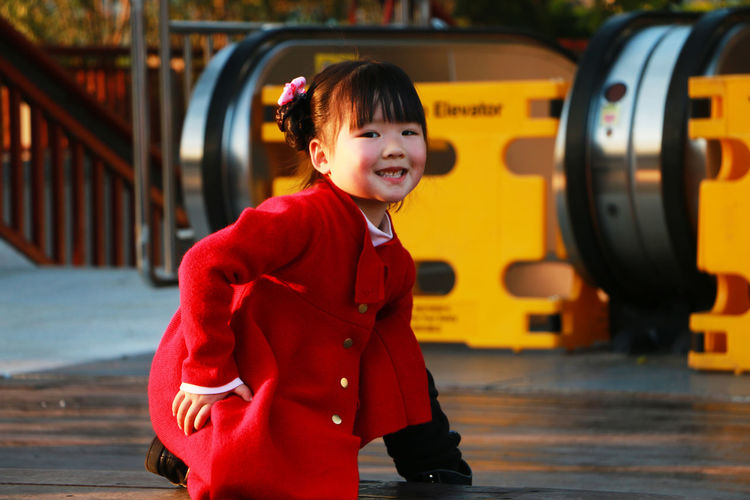 The little girl Looking at the camera smiling in red Childhood Child Real People One Person Innocence Portrait Lifestyles Three Quarter Length Looking At Camera Clothing Leisure Activity Smiling Cute Red Warm Clothing Hairstyle Female Girl Asian  China Chinese Beautiful Beauty Happiness Backgrounds Winter Guangzhou Blur Blurred Sunset Sunlight Warm Yellow Color Outdoors