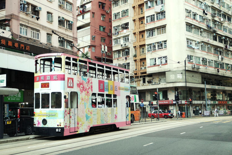 Architecture Building Building Exterior Built Structure City City Street Day Outdoors People Street Tram Transportation