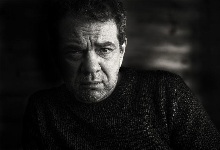 Close-Up Portrait Of A Serious Man