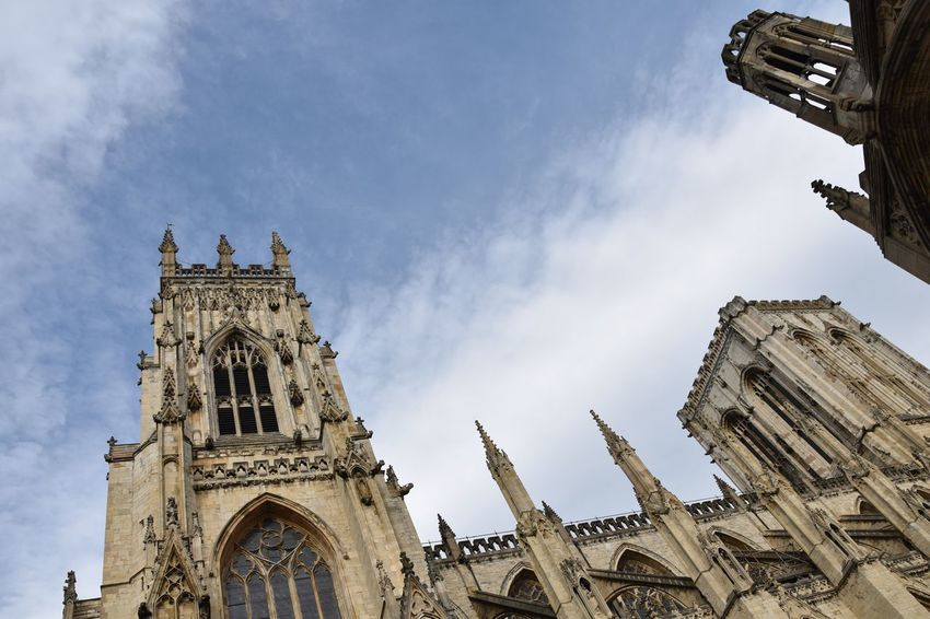 York Minster England Architecture Low Angle View Religion Building Exterior Sky Spirituality Place Of Worship Built Structure Cloud - Sky Day History Outdoors No People City York York Minster  Cathedral Old Buildings Historic Historical Building Historical Monuments Old Architecture Copy Space Architecture_collection Place Of Worship