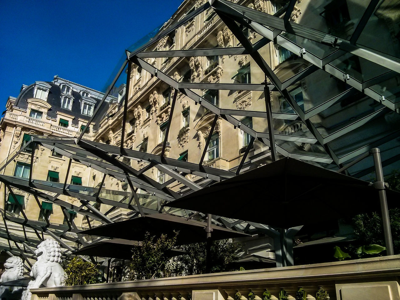 architecture, low angle view, built structure, building exterior, day, outdoors, no people, steps and staircases, roof, clear sky, tree, city, sky
