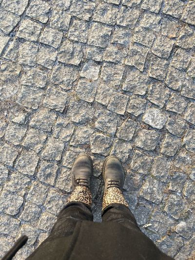 Autumn Boots Jeans Rockabilly Standing Woman Body Part Cobblestone Day Directly Above First Eyeem Photo High Angle View Human Body Part Human Leg Lifestyles One Person Outdoors Pattern Personal Perspective Real People Rockabilly Style Standing Street Streetphotography Unrecognizable Person