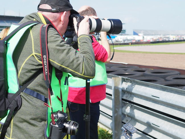 Media Vest Virgins Olympus OMD EM 1 Mark 11 Rockingham Speedway Activity Adult Backpack Camera - Photographic Equipment Clothing Day Digital Camera Excitementoverloaded Holding Leisure Activity Lifestyles Men Outdoors People Photographer Photographing Photography Themes Racing Cars Railing Real People Rear View Standing Technology Trackside Architecture Warm Clothing Winter Focus On The Story
