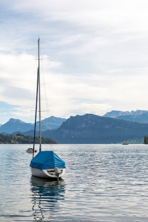 The mountains from Lake Lucerne Beautiful Berge Europe Lake Lucerne Lake Luzerne Landscape Lucerne, Switzerland Luzern Mountains Mountains And Sky Outdoors Sailboat Scenics Schweiz Schwiz Switzerland Tranquil Scene Travel Water