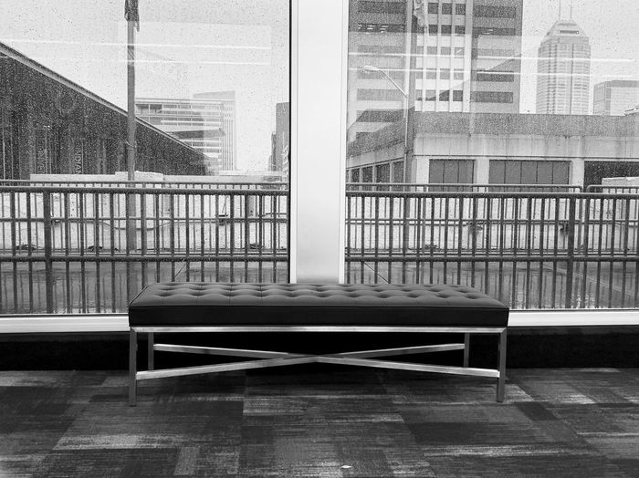 Empty chairs and tables in modern building