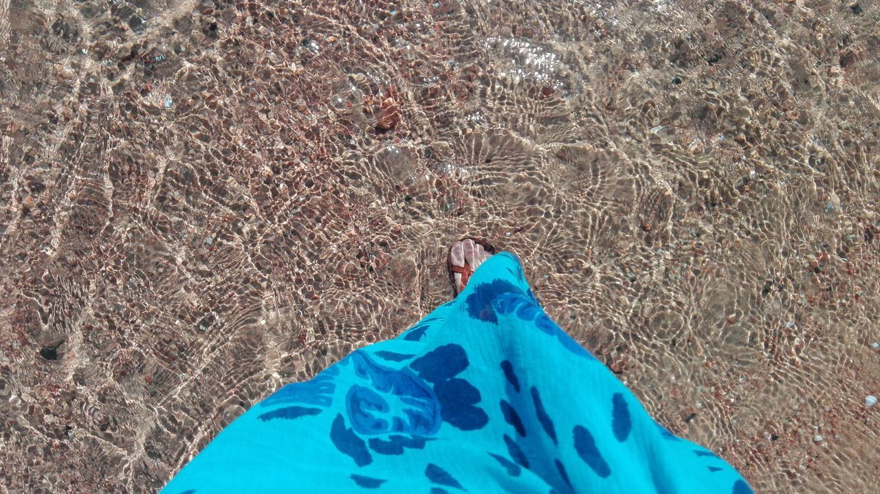 blue, day, land, nature, low section, human leg, high angle view, human body part, plant, real people, body part, personal perspective, people, textile, outdoors, lifestyles, women, adult, clothing, human foot