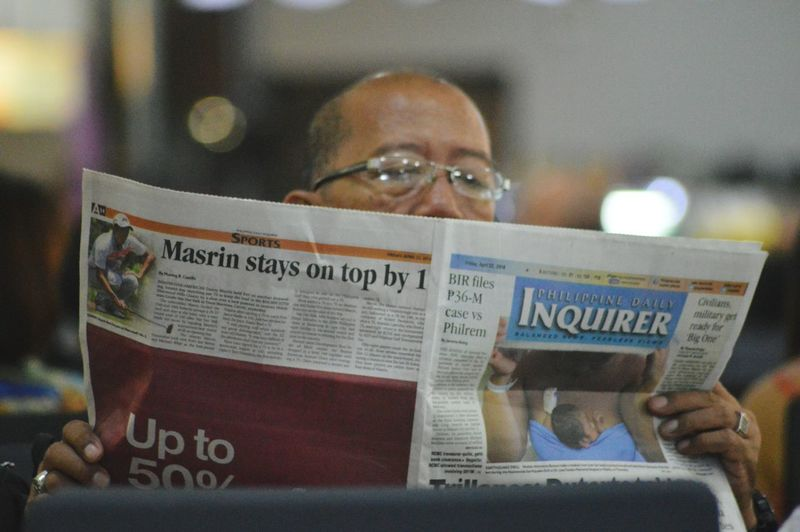 Reading the daily News Newspaper Airport Photography Airport Departure Check This Out Hello Philippines Get Updated People Photography People Reading News