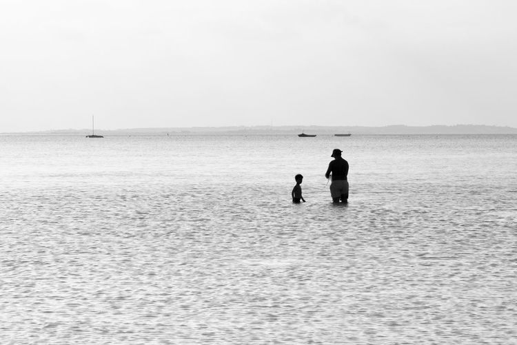 Father And Son Time Art Is Everywhere Beach Beauty In Nature Black & White Black And White Break The Mold Bw Father And Son Fishing Fishing Time Holiday Holidays Leisure Activity Ocean Scenics Sea Silhouette Silhouettes TCPM Togetherness Vacation Vacations Water The Great Outdoors - 2017 EyeEm Awards Live For The Story Place Of Heart Sommergefühle Breathing Space The Week On EyeEm Black And White Friday Summer Exploratorium Human Connection