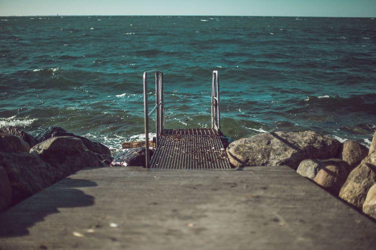 Pier leading towards seascape