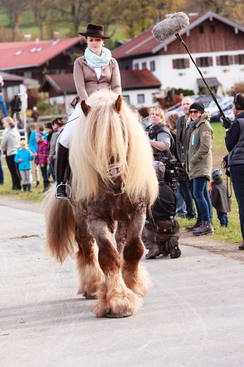 Hundham, Bavaria - November 4, 2017: Every year on the 1st Saturday in November the Idyllic Horse procession, named Leonhardi in the Bavarian Hundham takes place in memory of Patron St. Leonhard. In traditional clothing and decorated horse-drawn carriages horses and riders move to the church of St. Leonhard Autumn Bavaria Bavarian Lord God Catholic Church Hundham Leonhardi Leonhardi Ride Leonhardiritt Saint Leonhard Traditional Clothing Carriage Ceremony Cultures Horse Horse Procession Horse-drawn Vehicle Idyllic Men Outdoors Riders Rural Scene Tourism Traditonal Festival Women