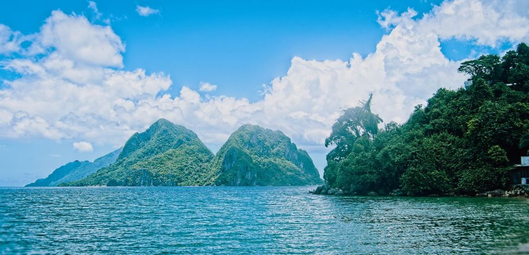 Palawan Philippines Sky Water Scenics - Nature Cloud - Sky Beauty In Nature Tranquil Scene Tranquility Waterfront Mountain Idyllic Sea Nature No People Day Tree Plant Non-urban Scene Blue Outdoors Turquoise Colored Bay Palawan Philippines Resort Ocean