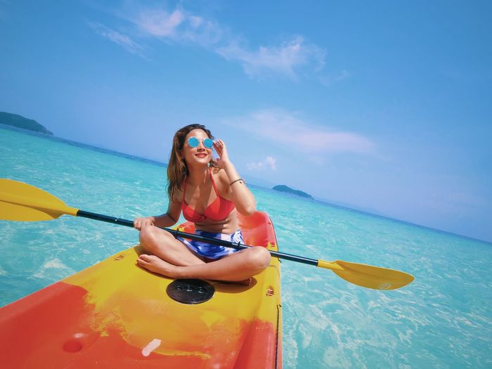 Travel Asian Girl Beach Andaman Kayaking Blue Sea Water One Person Leisure Activity Lifestyles Sea Real People Blue Adult Women Swimwear Young Women Young Adult Nature Day Sunlight Sky