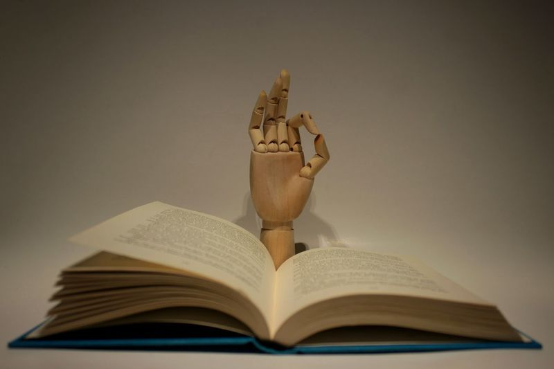 Book and hand, focus on hand Hand Book Books Bookstore Books ♥ Reading Reading A Book Home Interior Home Interior Kitchen Kitchen Art Toy Doll Doll Photography Read Book Education Learning Literature Page Indoors  No People Close-up Day One Person Human Hand Open Knowledge Indoors  EyeEmNewHere 50 Ways Of Seeing: Gratitude