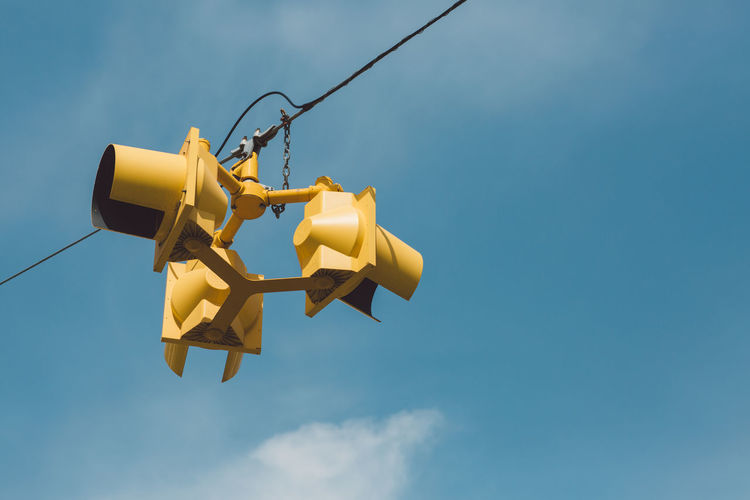 Low Angle View Of Road Light Against Blue Sky