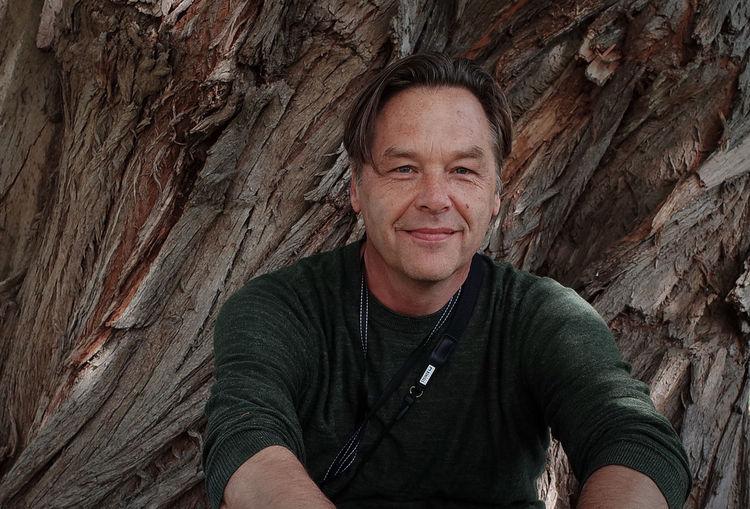 Portrait of smiling man on rock
