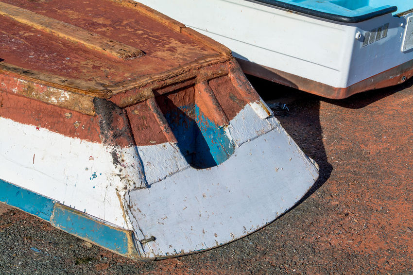 Boat Close-up Color Day Detail Deterioration Docks Empty Fishing Harbour Horizontal Jobs No People Outdoors Painted Part Of Run-down Stern Sunlight Sunny Tool Wooden
