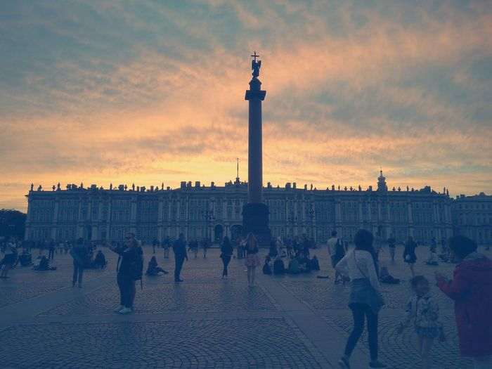 People At Palace Square Against Orange Sky