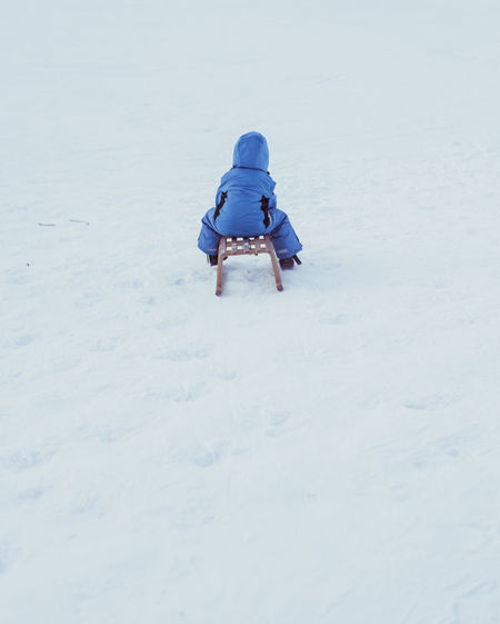 Adventure Boy Child Childhood Children Only Day Full Length One Person Outdoors People Rear View Sled Snow Vacations Winter