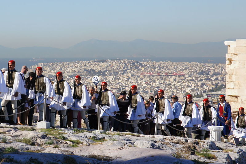 Evzones marching into the Acropolis Acropolis Acropolis, Athens Evzones Athens Athens, Greece Sunlight Ceremonial Ceremony Day Sky Architecture Outdoors Built Structure Greece Greece Photos Athens City Acropolis View