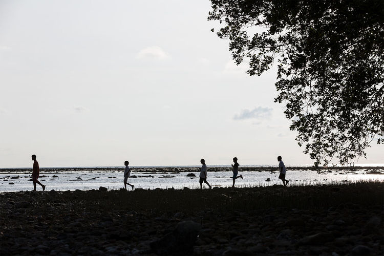 Thai children playing by the sea Beach Beauty In Nature Blackandwhite Children Horizon Over Water Leisure Activity Outdoors Playing Scenics Sea Shore Silhouette Sky Thailand Water