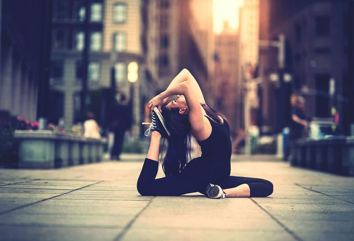 Girl dance City One Person Sitting Despair People Worried City Life Young Adult Women Adult Outdoors Flexibility Adults Only Young Women Human Body Part Only Women