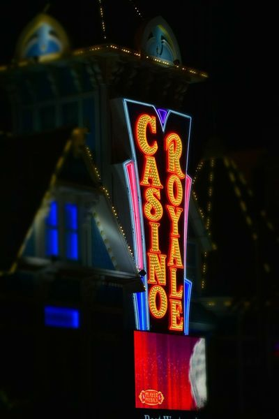 Vegas illuminations Las Vegas USA Casino Royale Illuminated Night Text Communication Travel Destinations Neon Low Angle View Travel Outdoors Tourism History Architecture Building Exterior Built Structure No People Multi Colored Close-up Clock