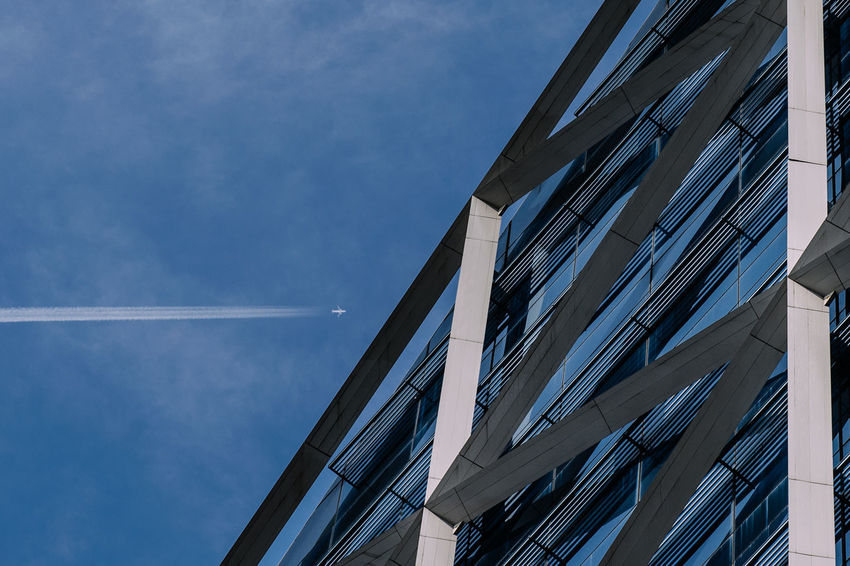Aeroplane Architecture Building Exterior Built Structure Contrail Day Low Angle View No People Outdoors Sky Vapor Trail Adapted To The City Miles Away
