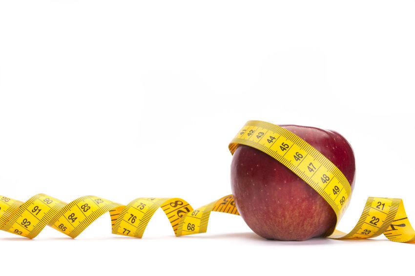 Yellow measure tape around a red apple as a weight loss concept Apple Diet Eating Healthcare Red Supplement Vegetarian Calories Concept Food Fresh Fruit Healthy Eating Loss Lossantos Measure Measuring Meter - Instrument Of Measurement Nutrition Slimming Spiral Tape Weight White Background Yellow