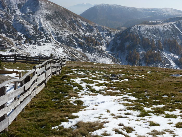 Fence On Field Against Mountains During Winter