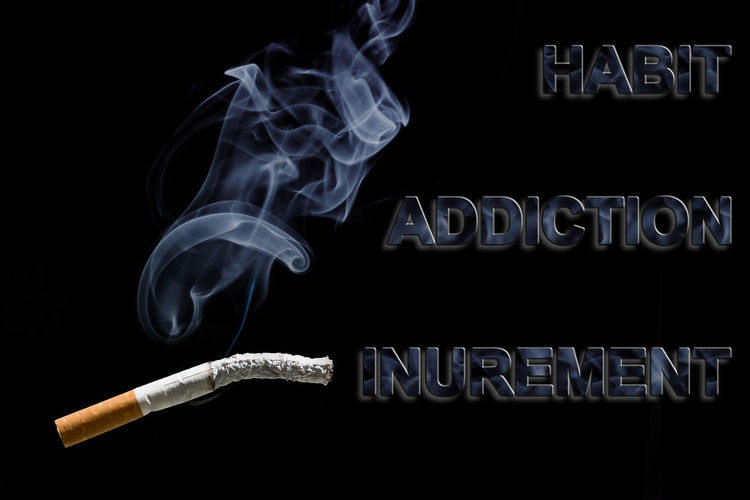 Burned cigarette and text Habit, addiction and Inurement Addict Addicted Addiction Addictions  Addictive Burn Burning Cancer Cigarette  Dependency Drug Fume Habit Harmful Illness Neoplasia Nicotine Smoke Smoker Text Tobacco Tumor Unhealthy