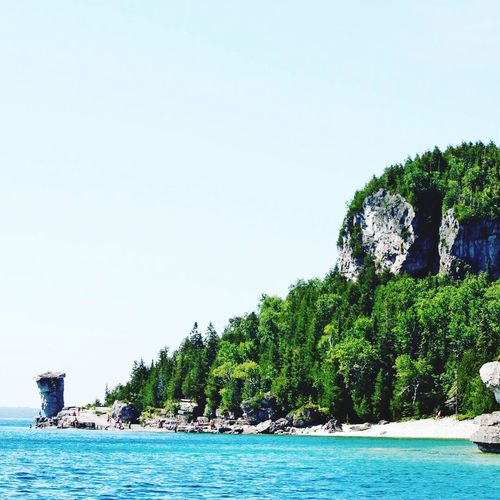 Flowerpotisland Bruce Peninsula Georgian Bay Turqoise Blue Tranquility Day Outdoors Scenics Nature Clear Sky Water Tree Beauty In Nature Cliff Horizon Over Water Sea Tranquil Scene Lake