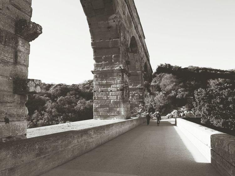 Pont du Gard, monochrome Architecture History Outdoors Travel Destinations Day Sky Scenics Building Exterior Bridge Roman UNESCO World Heritage Site Pontdugard  Languedoc France Tranquil Scene Tranquility Quiet Bridge - Man Made Structure Placid  People Blackandwhite Monochrome EyeEm Best Shots Eye4photography  EyeEm Gallery
