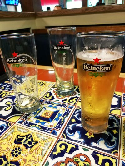 Heineken Drink Beer Beer Time Relaxing Alcoholic Drink Drink Refreshment Food And Drink Glass Household Equipment Alcohol Table Drinking Glass Close-up No People Restaurant Bar - Drink Establishment