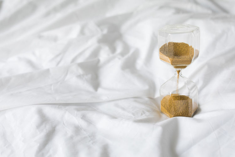 High angle view of white wine on bed