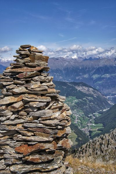 Alpine Architecture Alps Beauty In Nature Cloud - Sky Day Landscape Mountain Mountain Range Mountains Nature No People Outdoors Physical Geography Scenics Sky Stack Stone Stone Figure Stones Tranquil Scene Tranquility Valley