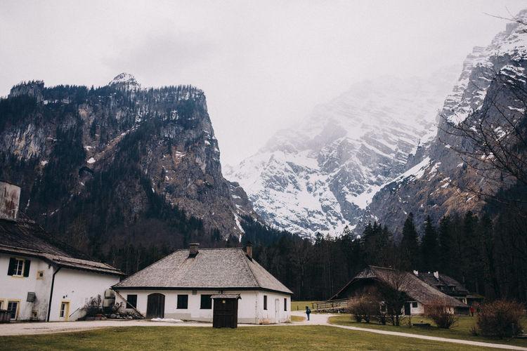 Houses on mountains against sky