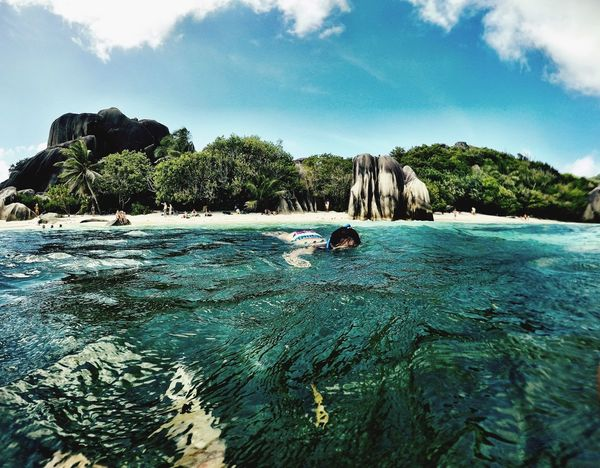 La Digue Anse Source D'argent Snorkeling In The Water Gopro Water Tree Rock - Object Day Nature Sky Beauty In Nature Scenics Tranquility Tranquil Scene Waterfront Outdoors Sea Amazing Nature Amazing Places Best Beach In The World Crystal Clear Waters Sommergefühle