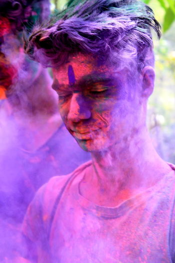 Close-up of man during holi