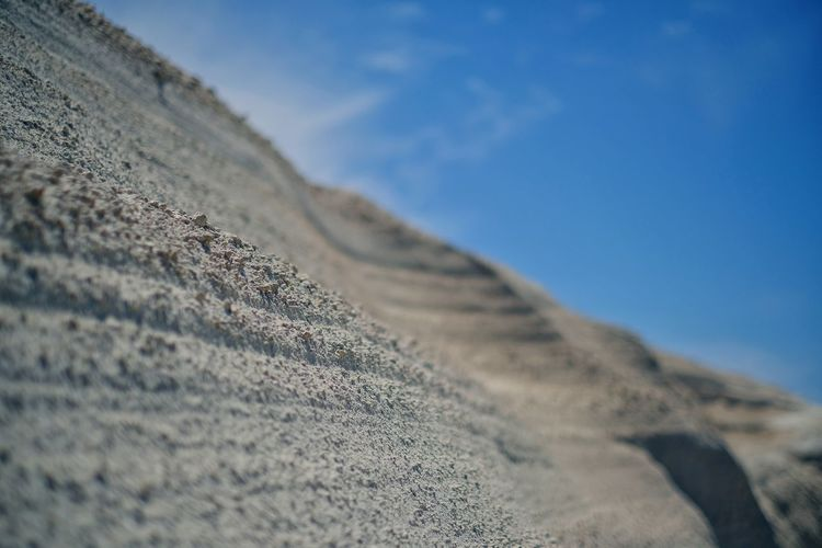 Surface level of sand on land against sky