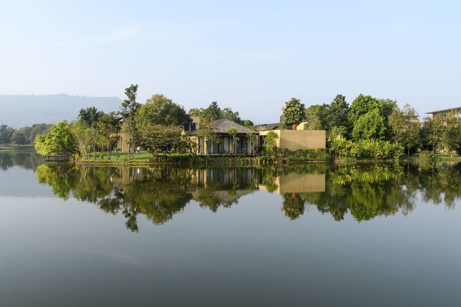 Lake side reflection, Khao Yai, Thailand Architecture Beauty In Nature Building Exterior Built Structure Day House Nature No People Outdoors Reflection Sky Tree Water Waterfront