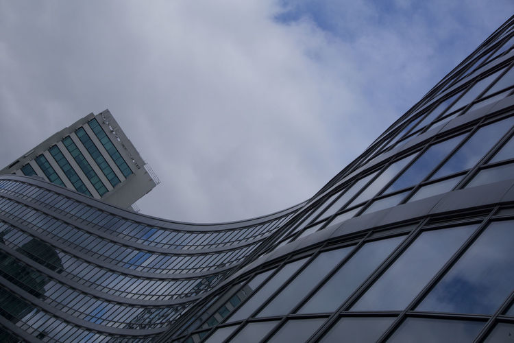 Reflection of clouds in curved glass building at Manchester Piccadilly Manchester Picadilly Station Architecture Building Exterior Built Structure City Sky Modern Building Office Building Exterior Cloud - Sky Office Glass - Material Low Angle View No People Nature Skyscraper Outdoors Day Tall - High Tower Business Directly Below