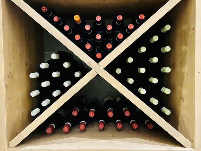 High angle view of bottles on shelf