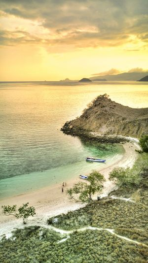 Komodo Island, Flores, Indonesia. Scenics - Nature Beauty In Nature Komodo Island Flores INDONESIA Tropical Climate Sunset Sky Tranquil Scene Tranquility No People Nature Cloud - Sky Idyllic Outdoors Sea Water Horizon Over Water Horizon Drone Shot Aerial View Drone  Land